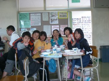 Students eat in their classrooms with members of their han group.