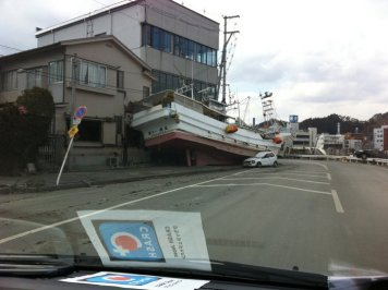 Boat washed up against a building in Japan by the recent tsunami