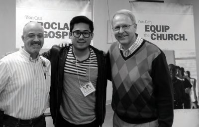 SIM USA's Bob Hay (left) and Bruce Johnson (right) welcome A2 missionary candidate Garrett Inouye through SIM's pre-field training.