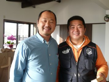 Standing with Pastor Koji Kumada, the Mennonite Brethren pastor of the church, originally planted by the Conservative Baptists.