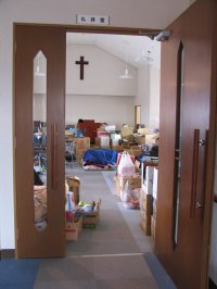 Sanctuary at Shiogama Bible Baptist Church filled with relief supplies