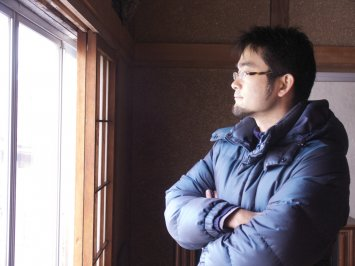 Pastor Kondo looking out the window of the new volunteer training center.