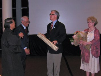 Pastor Ariga and Mr. Maehara present gifts to Doug and Jeanie Birdsall to celebrate their 30th anniversary with Asian Access.