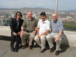 Joe in Mongolia with Pastor Chinzorig, Pastor Ariunbold, of and Bruce Johnson