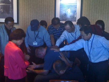 Japanese pastors praying for me while on the 2009 vision tour to the North West