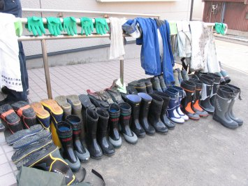 Boots used by volunteers to help clean out the mud from homes in the Tsunami stricken areas of northern Japan.