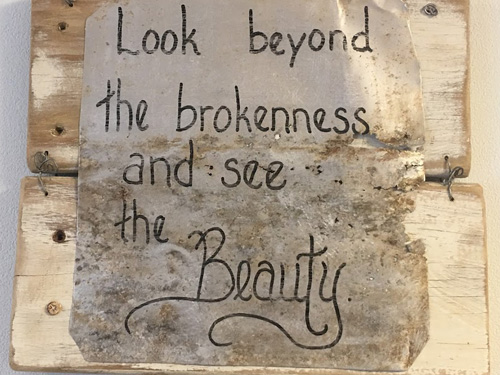brokenness beauty sign